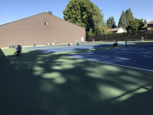 Picture of wheelchair participants on the tennis courts at Salem Swim and Tennis Club